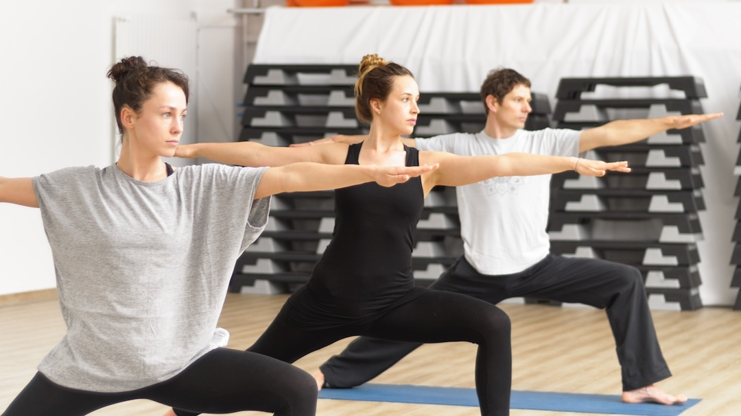 Instructor and Students in a Yoga Class